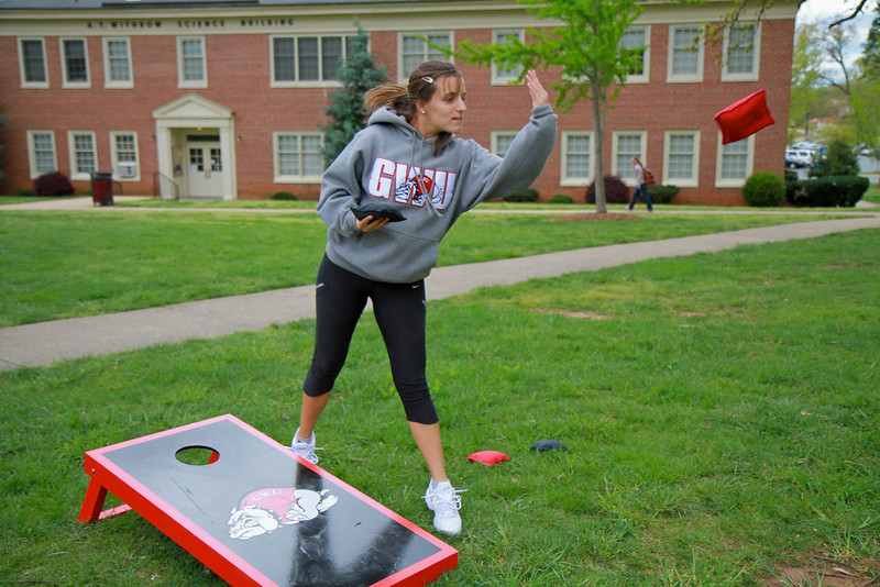 Students play cornhole on the quad.