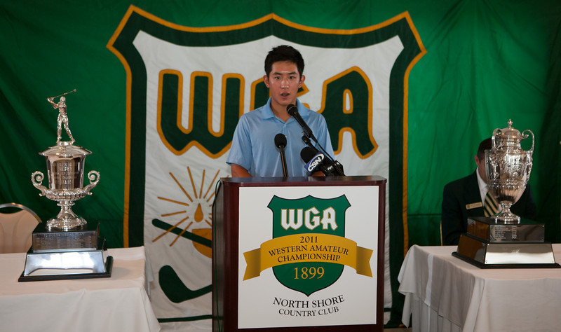 David Chung stands between the two Western Amateur trophies.