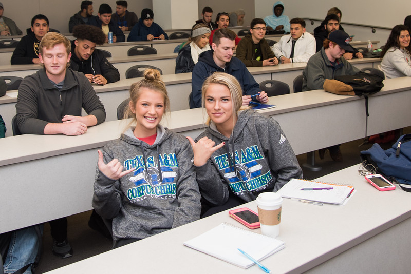 Gabby Johston (left) and Maya Daukas show off their Islander pride during their Intro to Business Environment class on the first week of school.