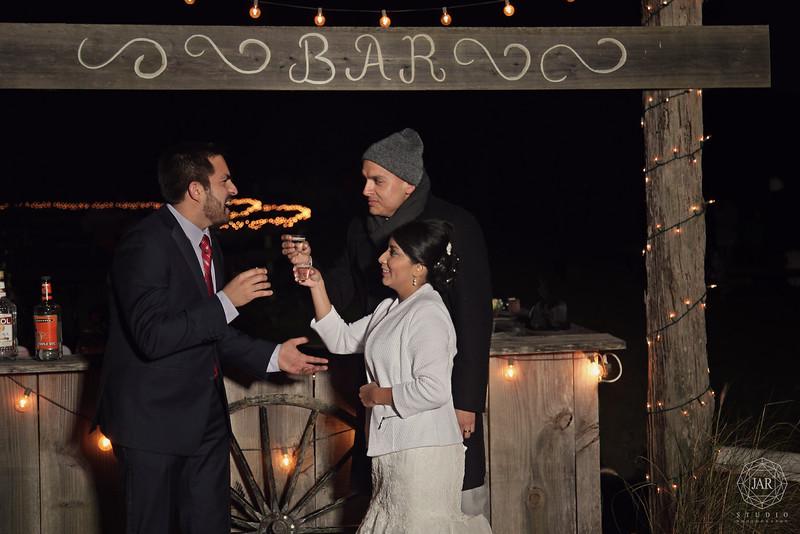 17-bride-groom-fun-bar-lights-rustic-isola-farms-jarstudio.jpg