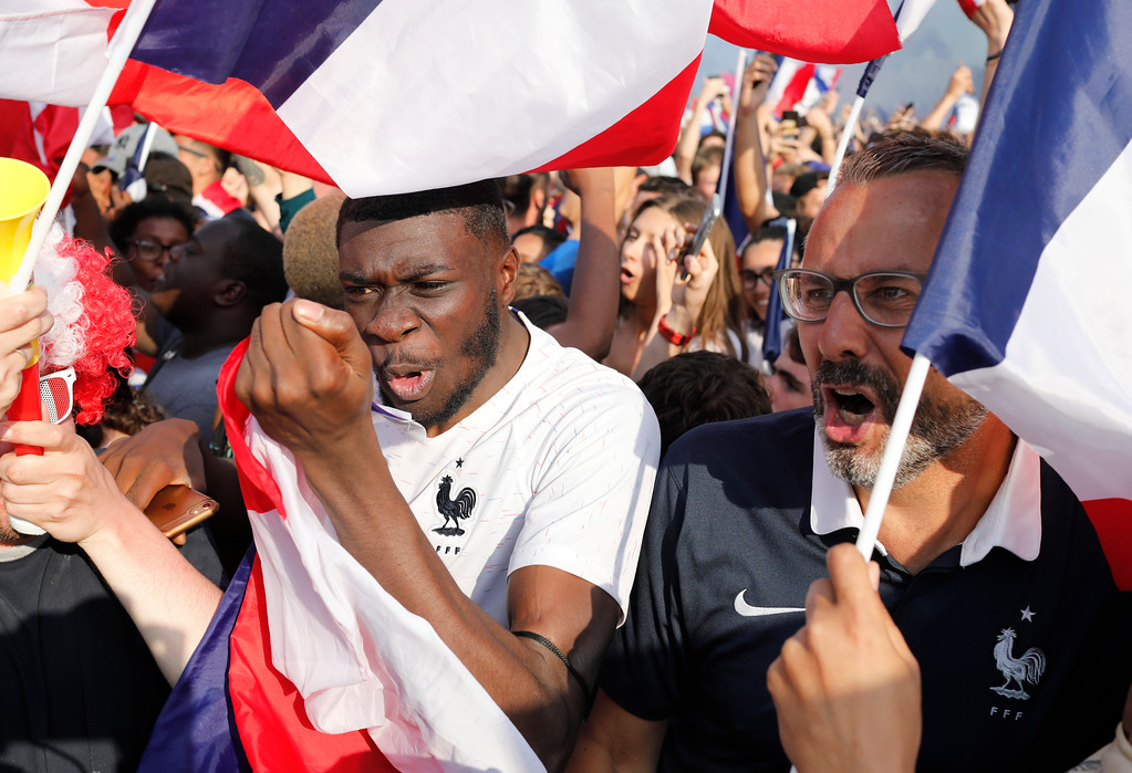 . French soccer team supporters celebrate as France wins the World Cup final between France and Croatia, Sunday, July 15, 2018 in Paris. France won its second World Cup title by beating Croatia 4-2. (AP Photo/Laurent Cipriani)