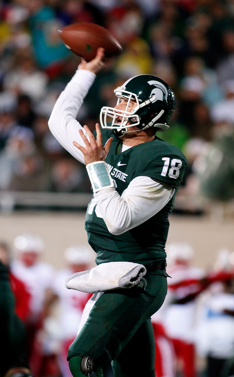 . Michigan State quarterback Connor Cook throws a pass against Nebraska during the first quarter of an NCAA college football game, Saturday, Oct. 4, 2014, in East Lansing, Mich. (AP Photo/Al Goldis)