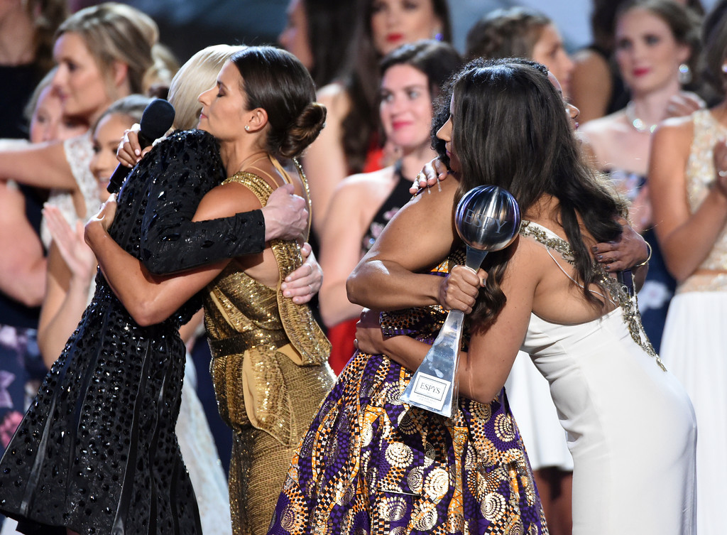 . Recipients of the Arthur Ashe Award for Courage Sarah Klein, left, former Michigan State University softball player Tiffany Thomas Lopez, second from right, gymnast Aly Raisman, right and host Danica Patrick, second from left embrace at the ESPY Awards at the Microsoft Theater on Wednesday, July 18, 2018, in Los Angeles. (Photo by Phil McCarten/Invision/AP)
