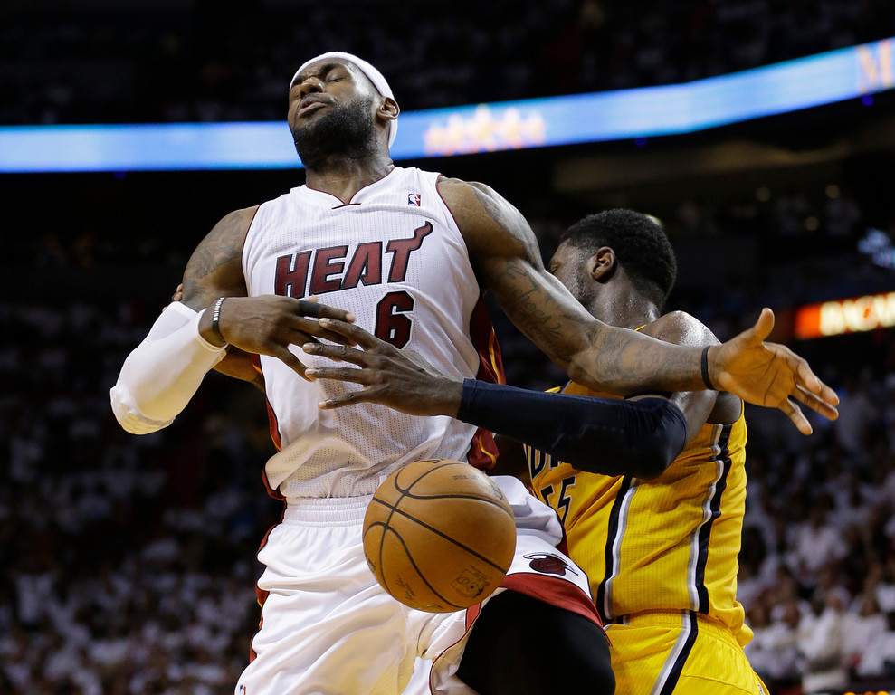 . Indiana Pacers center Roy Hibbert (55) blocks a shot to the basket by Miami Heat\'s LeBron James (6) during the second half Game 6 in the NBA basketball playoffs Eastern Conference finals on Friday, May 30, 2014, in Miami. (AP Photo/Lynne Sladky)