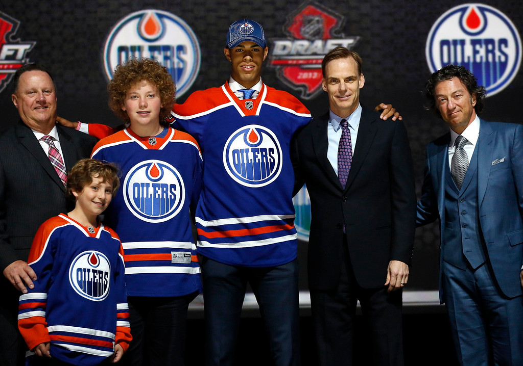 . Darnell Nurse poses in an Edmonton Oilers jersey after being selected by the Oilers as the seventh overall pick in the 2013 National Hockey league (NHL) draft in Newark, New Jersey, June 30, 2013. REUTERS/Brendan McDermid