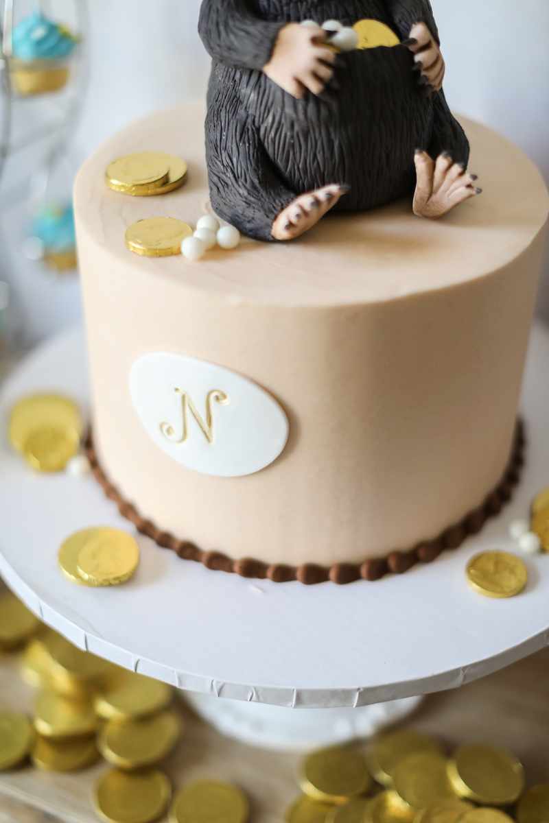 N monogram cake for 9-year-old birthday with a niffler theme.