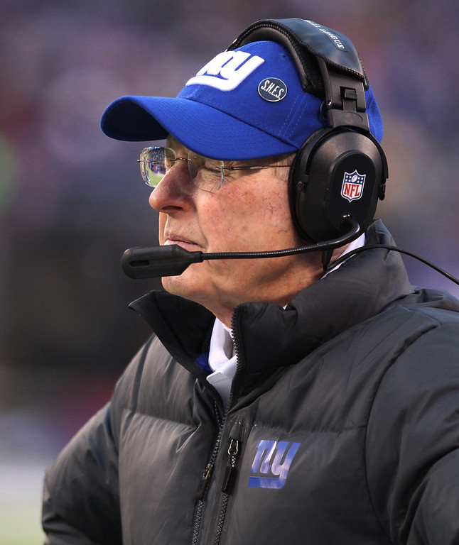 . New York Giants head coach Tom Coughlin reacts after Seattle Seahawks wide receiver Doug Baldwin pushed over defenders to score on a touchdown pass from quarterback Russell Wilson during the second half of an NFL football game, Sunday, Dec. 15, 2013, in East Rutherford, N.J. (AP Photo/Peter Morgan)