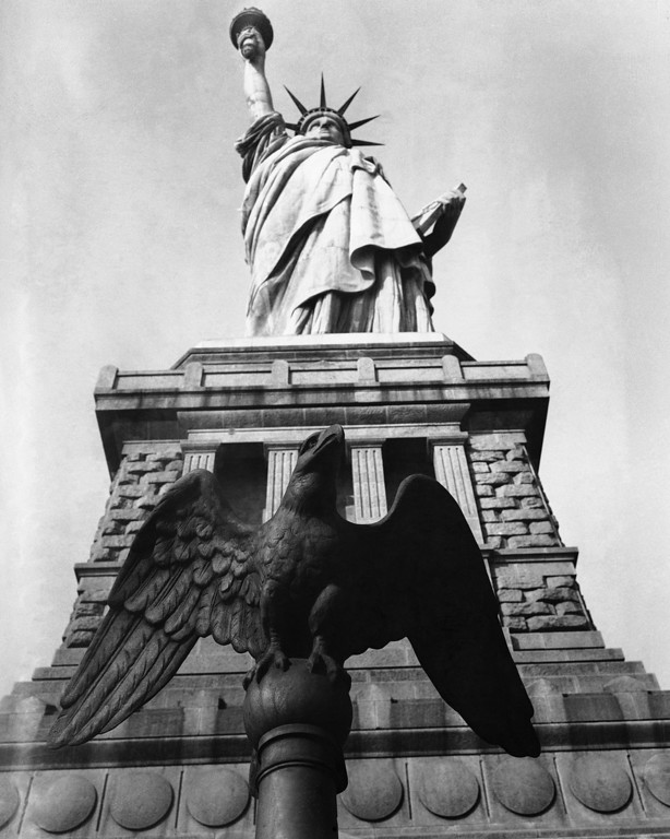 . None entering New York Harbor fails to catch a glimpse of the Statue of Liberty on Bedloe\'s Island in New York City, as seen Jan. 18, 1934. (AP Photo)