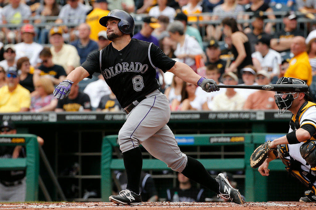 . Colorado Rockies\' Michael McKenry hits a solo home run off Pittsburgh Pirates starting pitcher Jeff Locke during the second inning of a baseball game in Pittsburgh Sunday, July 20, 2014. (AP Photo/Gene J. Puskar)