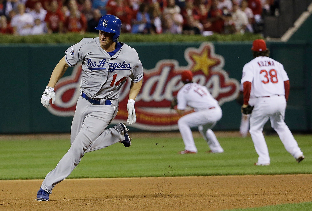. Los Angeles Dodgers\' Mark Ellis races to third for a triple during the 10th inning of Game 1 of the National League baseball championship series against the St. Louis Cardinals, Friday, Oct. 11, 2013, in St. Louis. (AP Photo/David J. Phillip)