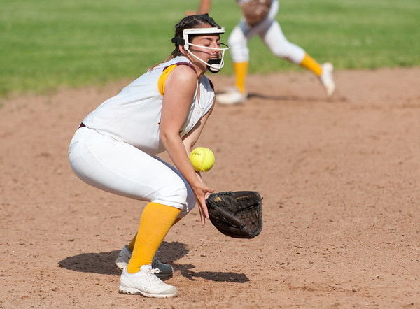 05/30/18 Wesley Bunnell | Staff New Britain softball defeated New Milford 13-10 in a first round CIAC Class LL tournament game on Tuesday afternoon at Martha Hart Park. Third baseman Amanda Jacobs (5) blocks the ball to keep it in front of her then recovers to throw to first for the out.