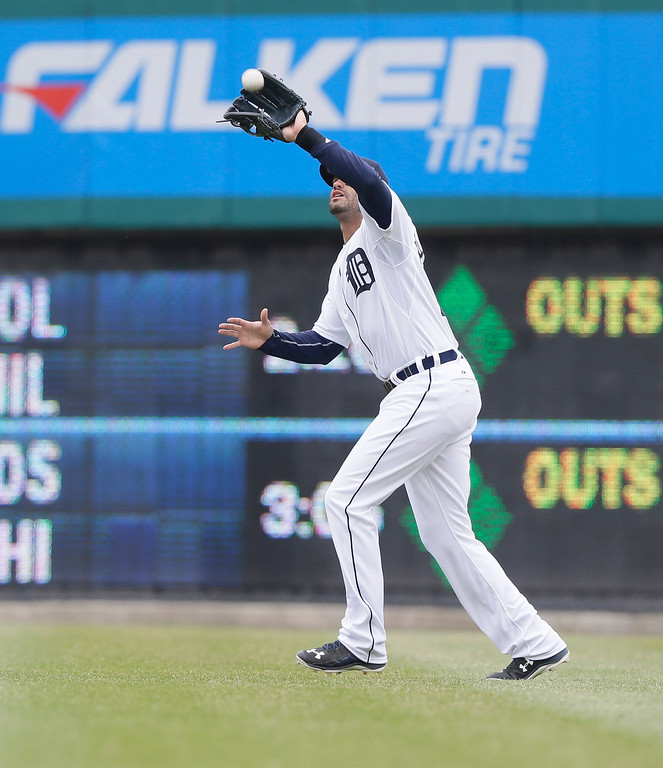 . Detroit Tigers right fielder J.D. Martinez catches the flyout hit by Minnesota Twins\' Torii Hunter during the fifth inning of an opening day baseball game in Detroit, Monday, April 6, 2015. (AP Photo/Carlos Osorio)