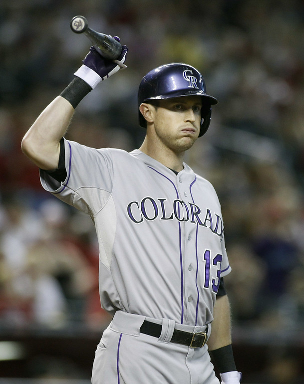 . Drew Stubbs #13 of the Colorado Rockies reacts after striking out against the Arizona Diamondbacks to end the third inning of a MLB game at Chase Field on August 9, 2014 in Phoenix, Arizona.  (Photo by Ralph Freso/Getty Images)