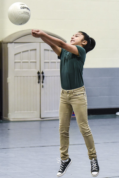 Michelle Quinones, 10, bumps the volleyball during Sports Day hosted by Robert E. Lee students at Douglas Elementary School in Tyler, Texas, on Friday, May 19, 2017. The event was organized in part by teacher Mrs. Jones and her son Royland Black as a way to motivate and reward students for their hard work at the end of the school year. (Chelsea Purgahn/Tyler Morning Telegraph)