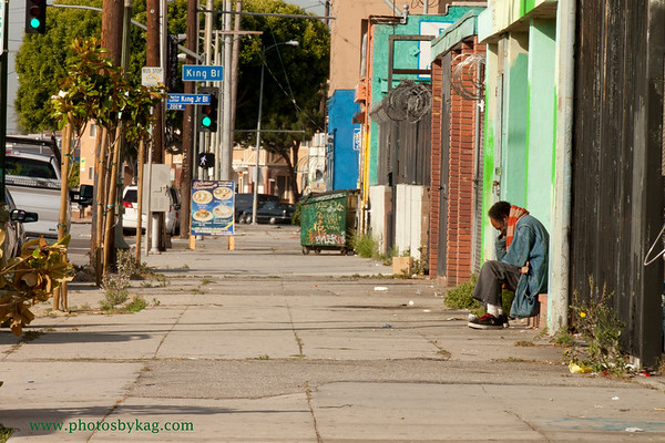Los Angeles street scene, MLK and Main Street 8:20 a.m. The despair on this man's face made me turn my car around. The trash, graffiti and barbed wire speak volumes about the current state of affairs in this neighborhood.