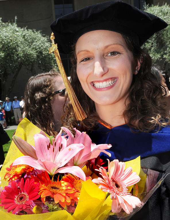 . Many graduates received flowers at the 120th Annual Commencement at California Institute of Technology Friday, June 13, 2014.(Photo by Walt Mancini/Pasadena Star-News)