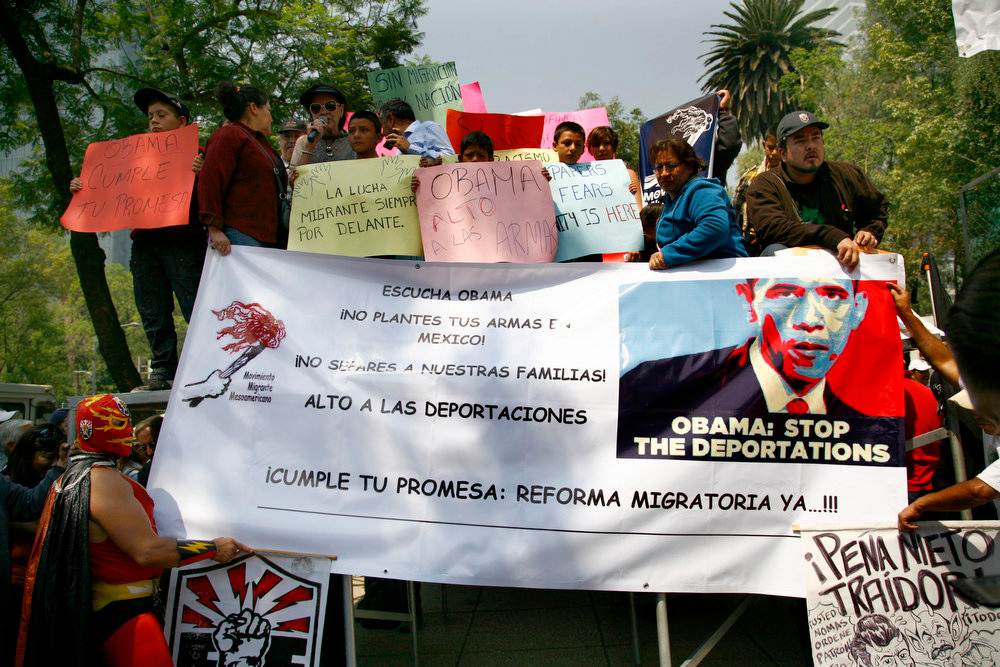 ". Demonstrators protest outside the U.S. embassy before the arrival of President Barack Obama in Mexico City, Thursday, May 2, 2013. The sign at center reads in Spanish ""Listen Obama. Don\'t plant your weapons in Mexico! Don\'t separate our families! Keep your promise : Migration reform now!\"" The protesters are from a former worker program called \""Braceros,\"" members of the Mexican Union of Electricians and a pro-migrant organization.  (AP Photo/Marco Ugarte)"