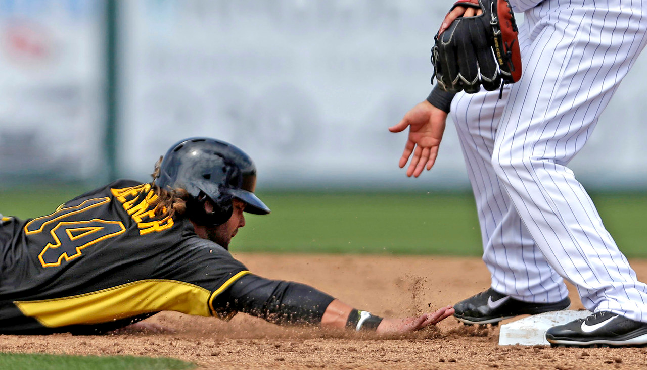 . Pirates base runner Jaff Decker avoids the tag by Twins shortstop Jason Bartlett on a pickoff attempt at second base in the third inning. (AP Photo/Gerald Herbert)