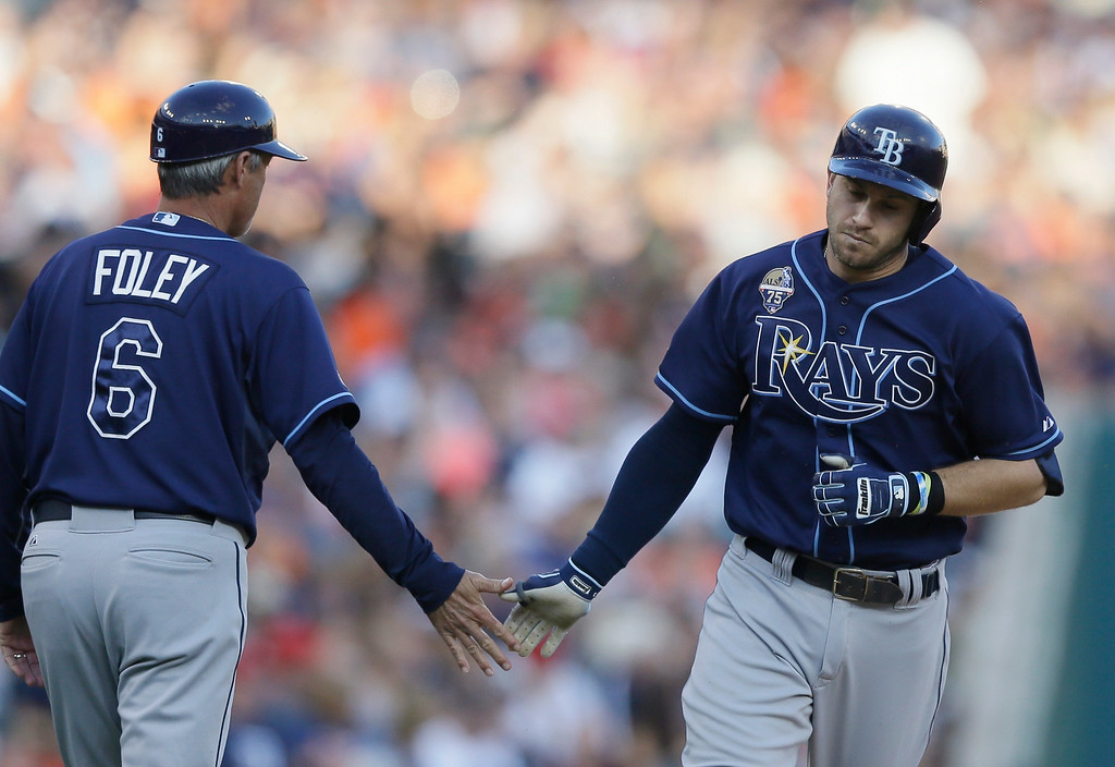 . Tampa Bay Rays\' Evan Longoria, right, rounds the bases and is congratulated by third base coach Tom Foley after his solo home run during the fourth inning of a baseball game against the Detroit Tigers in Detroit, Friday, July 4, 2014. (AP Photo/Carlos Osorio)