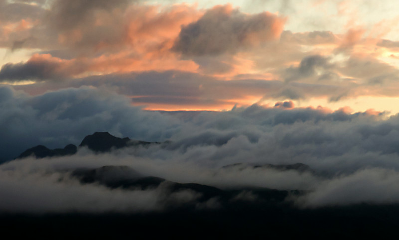sunset clouds across mountain close up.jpg