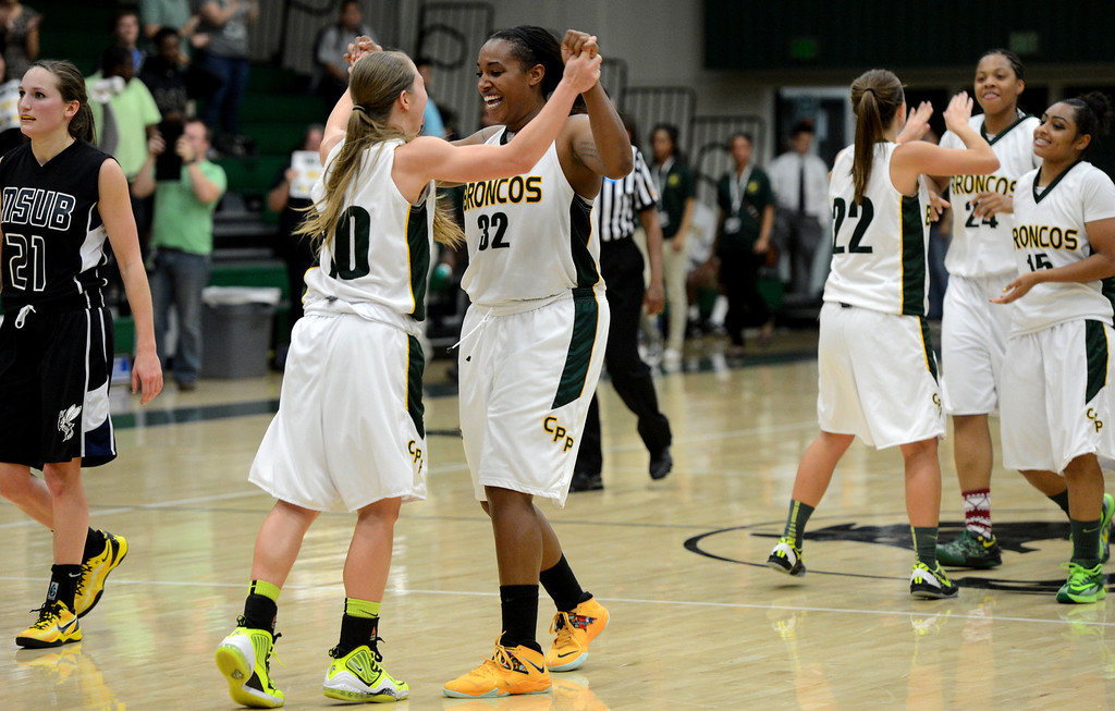 . Cal Poly Pomona\'s Ariel Marsh and Jada Blackwell celebrate their win over Montana State Billings during the NCAA Division II West Regional championship game at Cal Poly Pomona in Pomona, CA, Monday, March 17, 2014. (Photo by Jennifer Cappuccio Maher/Inland Valley Daily Bulletin)