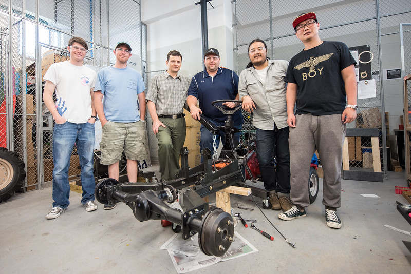 Corey Funk (left), Sterling Smith, Dr. Simionescu, Josh Houston, Prayoga, and Haiyong Zheng pose with their Basic Utility Vehicle (BUV) prior to traveling to the upcoming BUV competition in Batavia, Ohio.