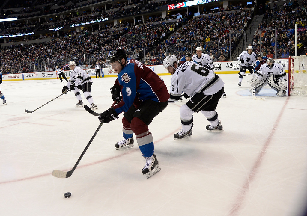 . DENVER, CO - FEBRUARY 18: Colorado Avalanche center Matt Duchene (9) gains control of the puck as Los Angeles Kings defenseman Jake Muzzin (6) moves in on defense during the third period February 18, 2015 at Pepsi Center. (Photo By John Leyba/The Denver Post)