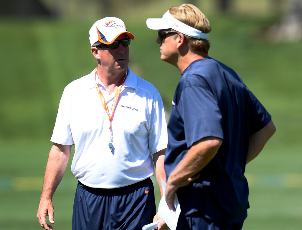 . Head Coach John Fox of the Denver Broncos talks with defensive coordinator Jack Del Rio during OTAs June 6, 2013 at Dove Valley. (Photo By John Leyba/The Denver Post)