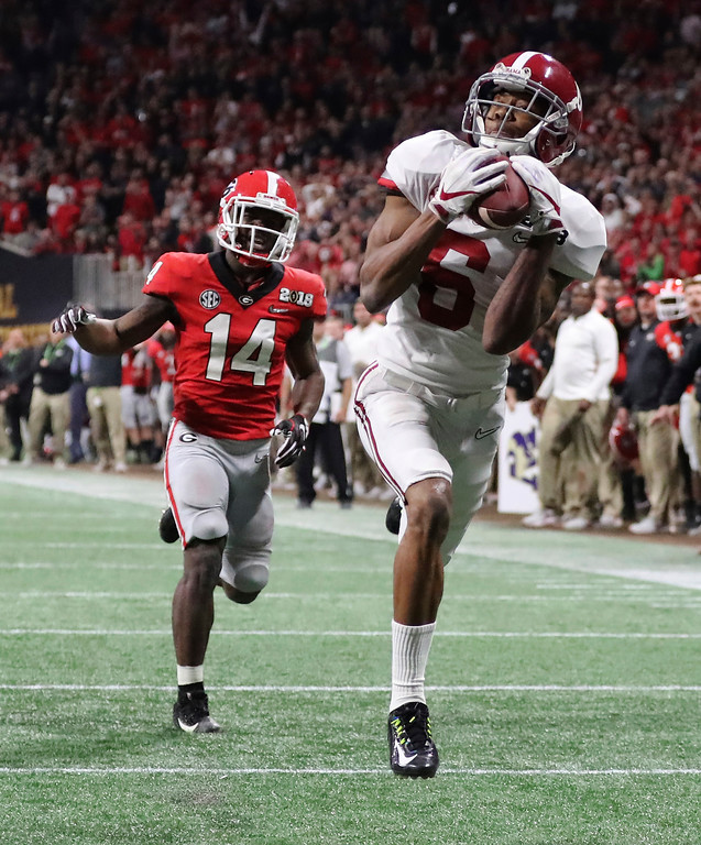 . Alabama wide receiver Devonta Smith catches a touchdown pass past Georgia defensive back Malkom Parrish during overtime of the NCAA college football playoff championship game in Atlanta on Monday, Jan. 8, 2018. Alabama won, 26-23. (Curtis Compton/Atlanta Journal-Constitution via AP)