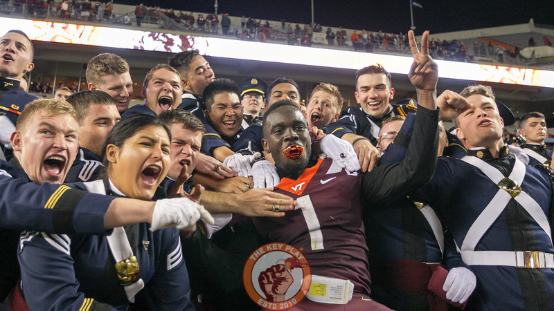 VT DB Reggie Floyd celebrates with the Corps of Cadets in the South endzone. The Hokies defeated UNC in 6OT, 43-41. (Mark Umansky/TheKeyPlay.com)
