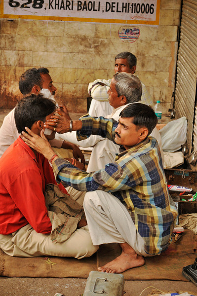 A haircut and a shave can always be found with the street barber. Here in Delhi.