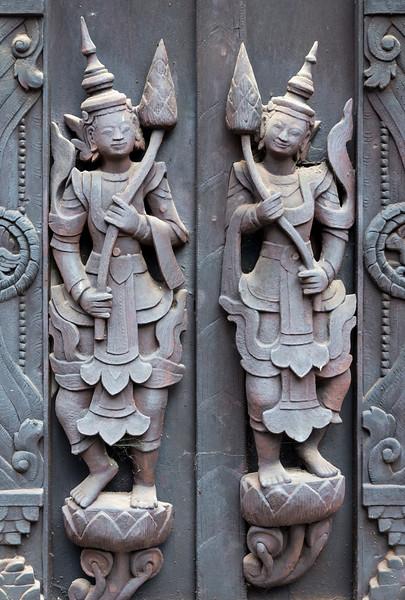 Detail of woodcarvings at the Shwe In Bin monastery in Mandalay, Burma - Myanmar