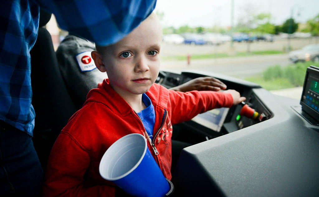 . 5-year-old Nolan Luther of Burnsville (he finished 10-months of chemo and his cancer is now in remission) sounds the train bell before the first train departed the Hamline Station on opening day.  (Pioneer Press: Ben Garvin)
