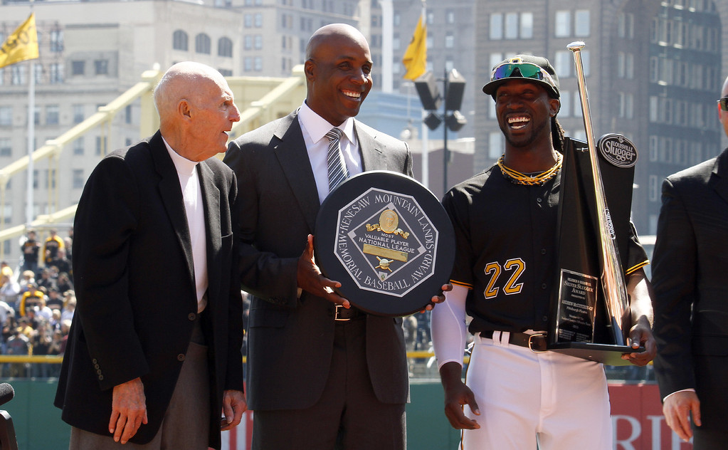 . Former Pirate MVPs Dick Groat and Barry Bonds stand with 2013 National League MVP Andrew McCutchen #22 of the Pittsburgh Pirates during Opening Day at PNC Park on March 31, 2014 in Pittsburgh, Pennsylvania.  (Photo by Justin K. Aller/Getty Images)