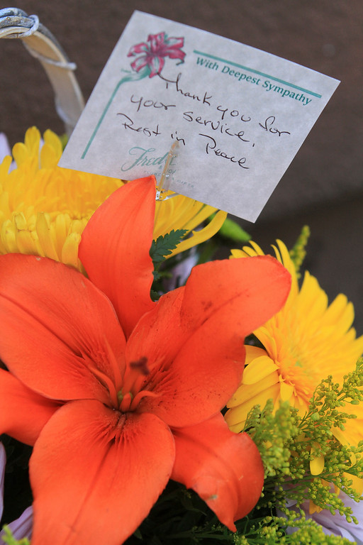 . Flowers and cards of condolences from the community sit outside the Hayward Police Department  in Hayward, Calif., on Wednesday, July 22, 2015. Sgt. Scott Lunger  was shot and killed early Wednesday morning during a routine traffic stop. (Laura A. Oda/Bay Area News Group)