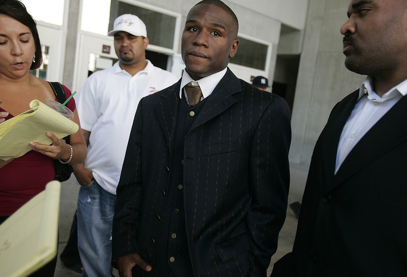 . Boxing champion Floyd Mayweather Jr., second from right, speaks to the media with his conditioning coach Leonard Ellerbe, right,  after being acquitted in a felony battery jury trial in Las Vegas, Friday, July 29, 2005, at the Clark County Courthouse.  (AP Photo/Joe Cavaretta)