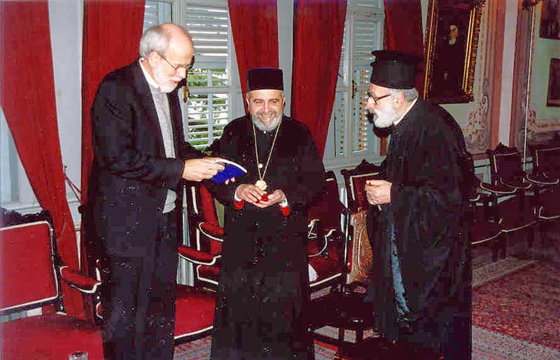 The ELCA delegation traveled to nearby Halki Island to visit an Orthodox monastery which was closed by government order 33 years ago. A small staff remains there while the Orthodox Church works with the government to reopen the facility. Bishop Hanson, left, presents gifts to Metropolitan Apostolos Daniilidis, center, monastery abbot; and Father Theodore, a monastery staff member.