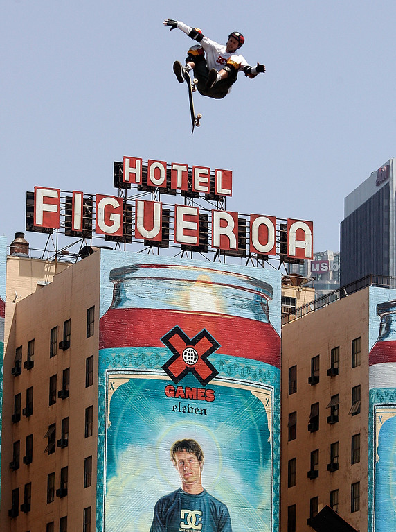. Danny Way of San Diego seems to fly through the air over the Hotel Figueroa and a huge painting of himself on his way to a gold medal in the Skateboard Big Air Finals during the Eleventh X Games at Staples Center in Los Angeles ,Calif., August 7. 2005.