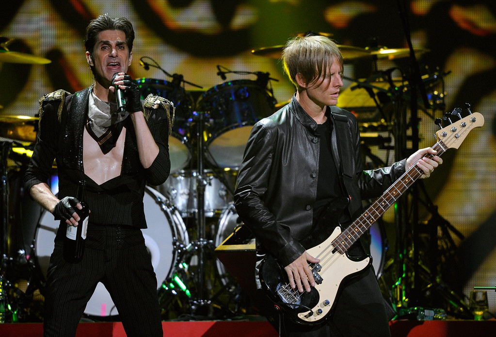 . LAS VEGAS, NV - SEPTEMBER 23:  Jane\'s Addiction singer Perry Farrell (L) and bassist Chris Chaney perform at the iHeartRadio Music Festival at the MGM Grand Garden Arena September 23, 2011 in Las Vegas, Nevada.  (Photo by Ethan Miller/Getty Images for Clear Channel)
