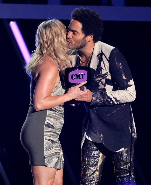 ". Lenny Kravitz, right, presents the award for female video of the year to Miranda Lambert for ""Mama\'s Broken Heart\"" at the 2013 CMT Music Awards at Bridgestone Arena on Wednesday, June 5, 2013, in Nashville, Tenn. (Photo by Donn Jones/Invision/AP)"