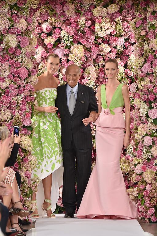 . Designer Oscar de la Renta (C) and model Karlie Kloss (L) walk the runway at the Oscar De La Renta fashion show during Mercedes-Benz Fashion Week Spring 2015 on September 9, 2014 in New York City.  (Photo by Slaven Vlasic/Getty Images)