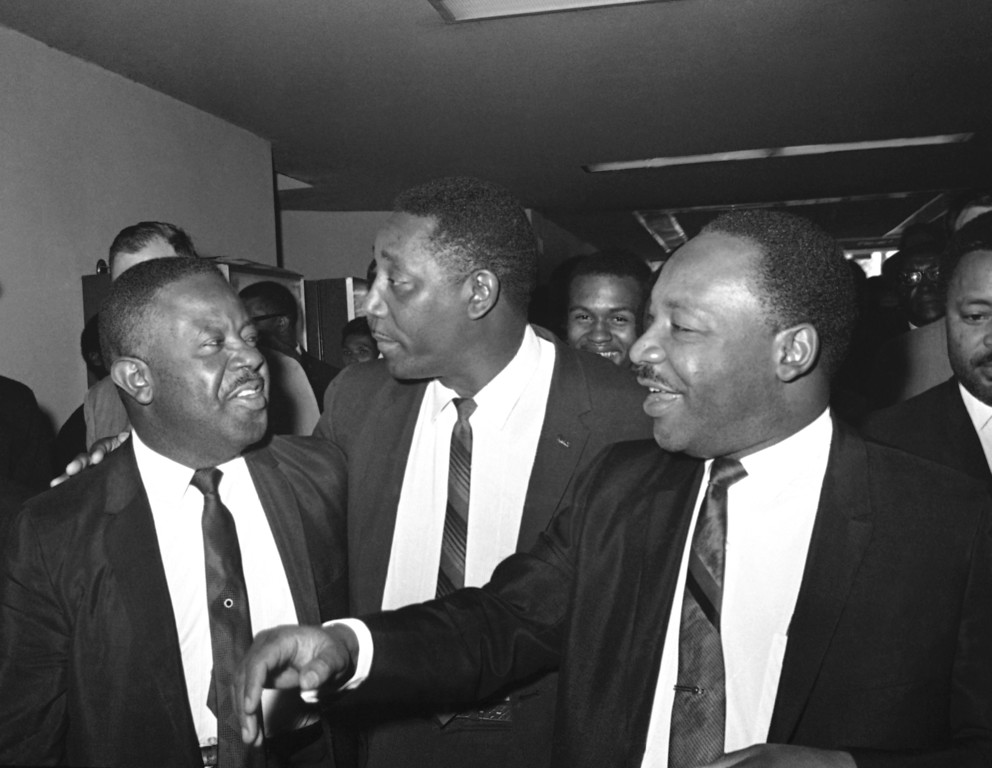 . From left to right: Ralph Abernathy, Charles Evers and Dr. Martin Luther King meet in Jackson, Mississippi, March 20, 1968 to hear King at the Poor Peoples March on Washington. (AP Photo/Jack Thornell)