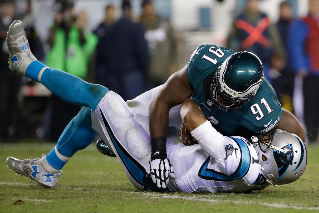 . Philadelphia Eagles\' Fletcher Cox (91) sacks Carolina Panthers\' Cam Newton (1) during the second half of an NFL football game, Monday, Nov. 10, 2014, in Philadelphia. (AP Photo/Matt Rourke)