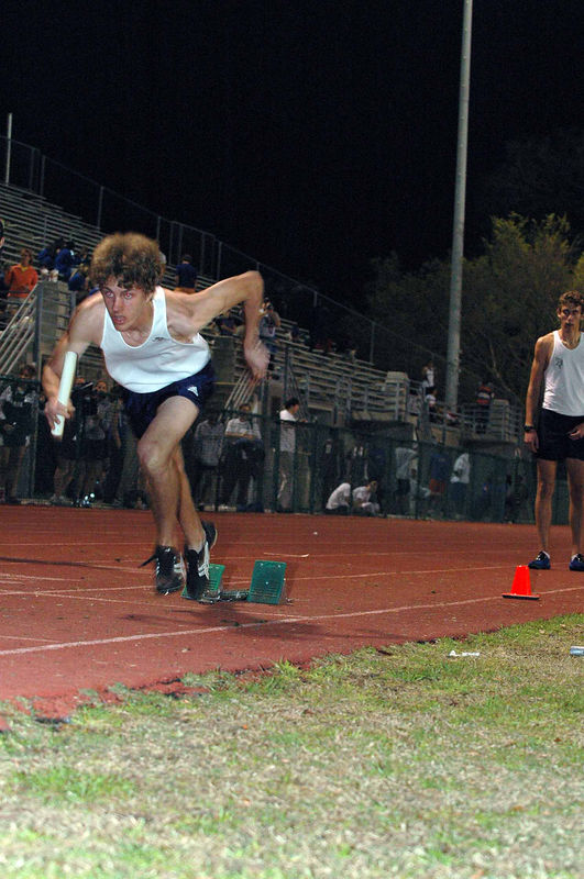 Sam reacts to the gun in his leadoff 400m leg. Kevan Post waits in lane 1 to pick up the blocks, then run second leg.