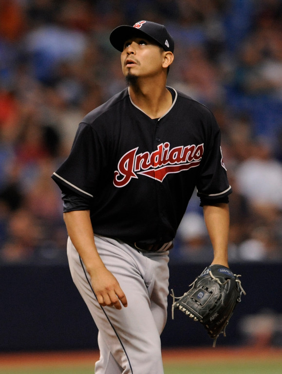 . Cleveland Indians starter Carlos Carrasco watches a foul ball during the third inning of a baseball game against the Tampa Bat Rays, Friday, Aug. 11, 2017, in St. Petersburg, Fla. (AP Photo/Steve Nesius)