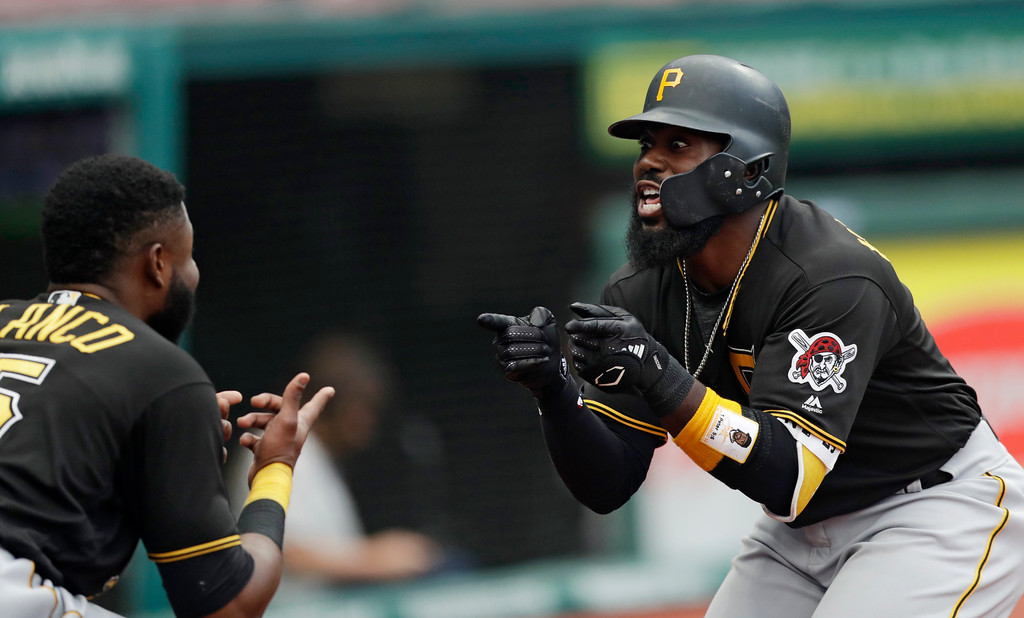 . Pittsburgh Pirates\' Josh Harrison, right, celebrates with Gregory Polanco after hitting a three-run home run in the second inning of a baseball game against the Cleveland Indians, Monday, July 23, 2018, in Cleveland. Josh Bell and David Freese scored on the play. (AP Photo/Tony Dejak)