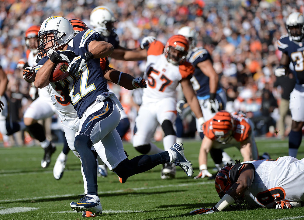 Description of . Chris Carr #22 of the San Diego Chargers returns the ball against the Cincinnati Bengals on December 2, 2012 at Qualcomm Stadium in San Diego, California. (Photo by Donald Miralle/Getty Images)