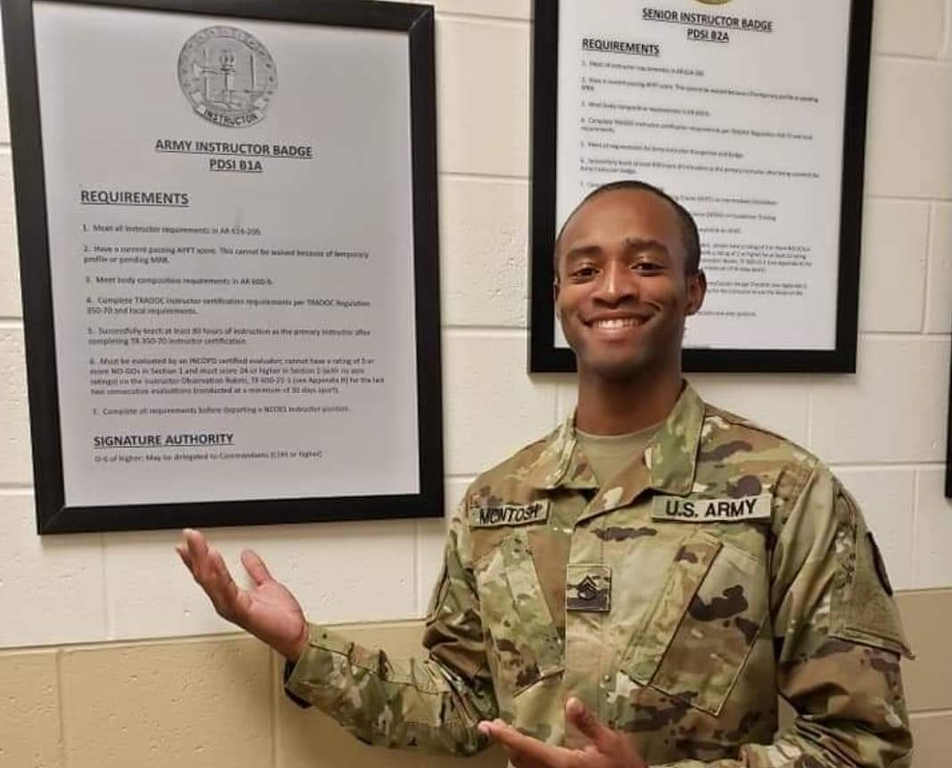 Jerrick McIntosh displays his Army Instructor Badge.