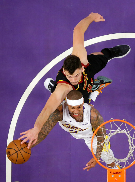 . Los Angeles Lakers guard Isaiah Thomas, below, has the ball knocked from his hands as he shoots by Cleveland Cavaliers forward Ante Zizic, of Croatia, during the first half of an NBA basketball game, Sunday, March 11, 2018, in Los Angeles. (AP Photo/Mark J. Terrill)