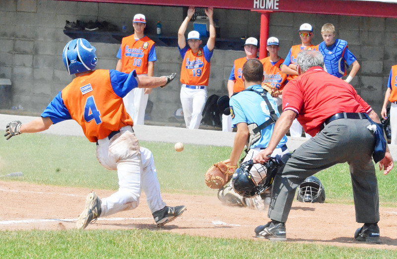 KYLE MENNIG - ONEIDA DAILY DISPATCH Oneida Post's Lukas Albro (4) slides safely into home as the ball gets away from Clinton County catcher Liam Rascoe (9) during their game in the American Legion Junior Baseball state tournament in Rome on Friday, July 29, 2016.